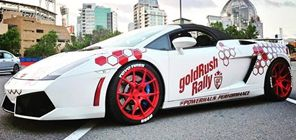 red and white Lamborghini with tire stickers