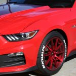 white michelin tire stickers - red ford mustang - front side view