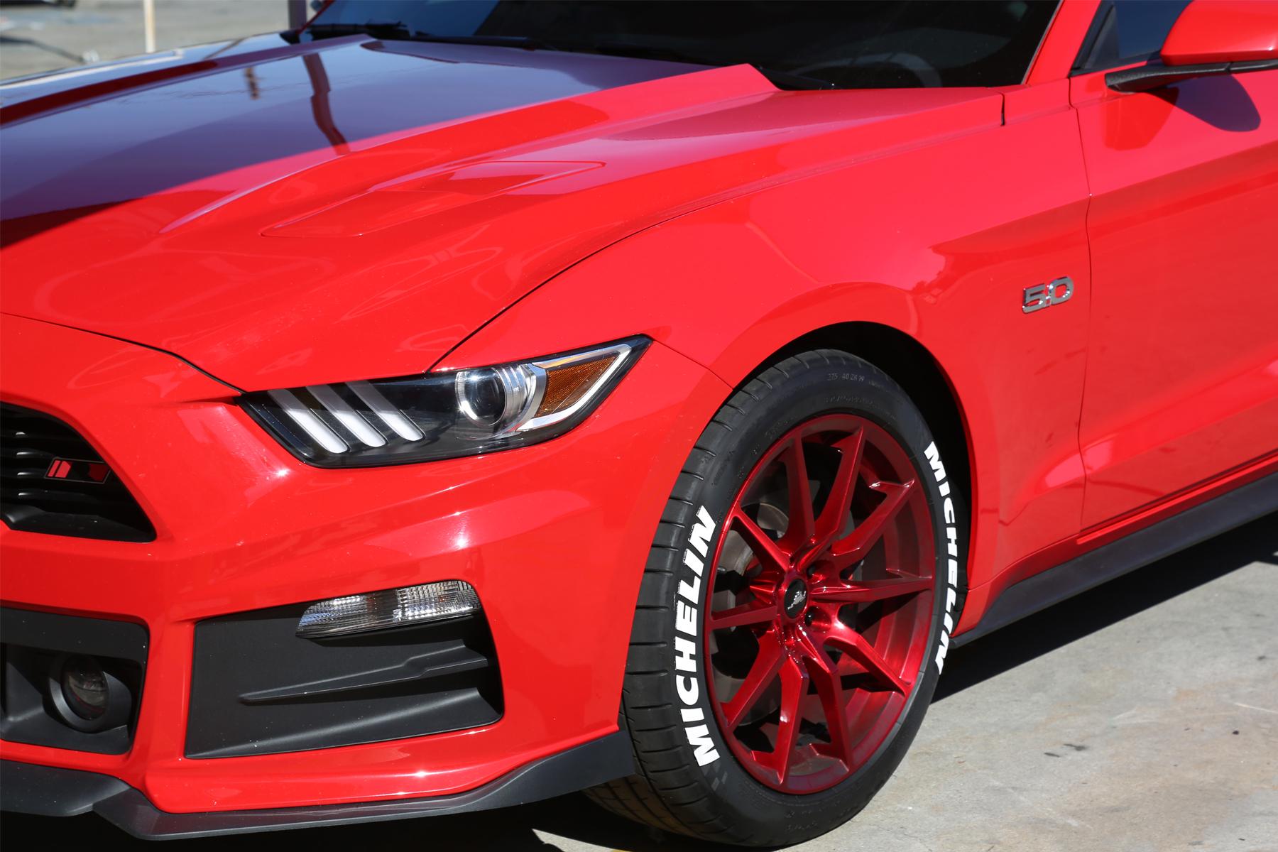 white michelin tire stickers red ford mustang front side